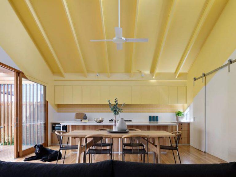 Yellow makes for a bright and happy kitchen. Picture: Tatjana Plitt