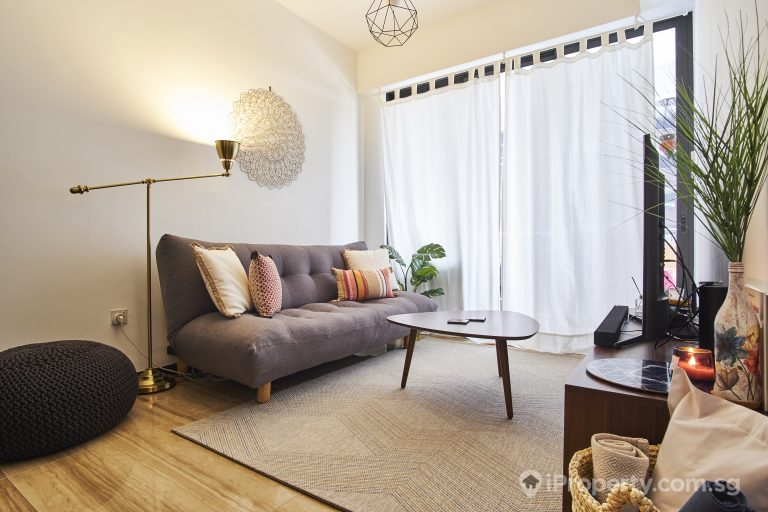Using a floor lamp to brighten up the living room.