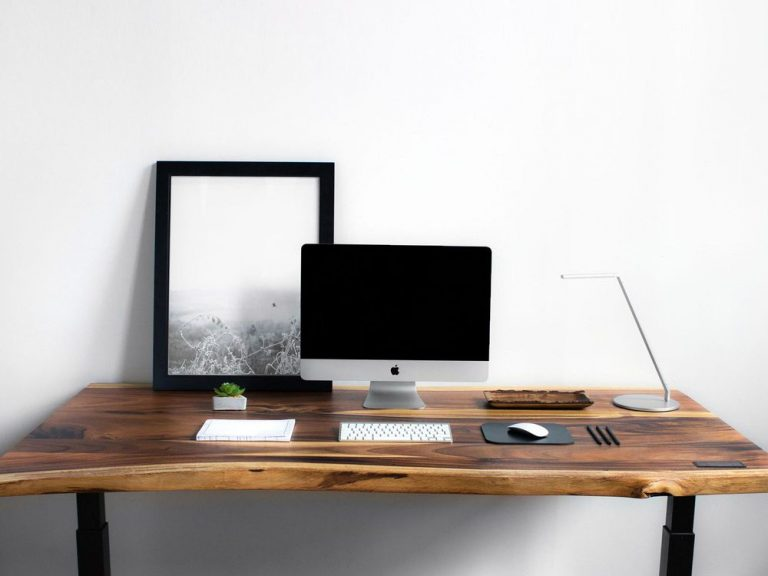 minimalist study table with a macbook