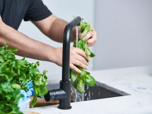 Washing your herbs is the first step to keeping them fresh. Picture: Ross Campbell