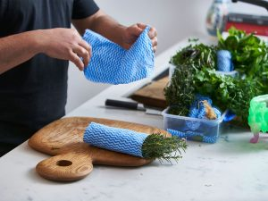 Wrap herbs in clean wet cloths before placing in the fridge. Picture: Ross Campbell