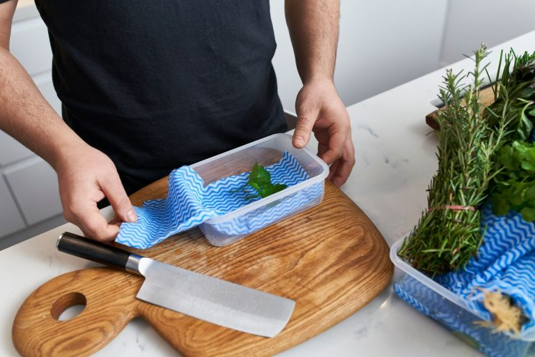 Store fresh herbs in a container of water in the fridge so they last longer. Picture: Ross Campbell