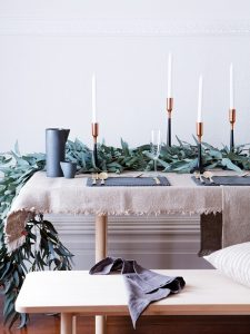Embrace plants and blooms and create height with candles. Picture: Linen Things