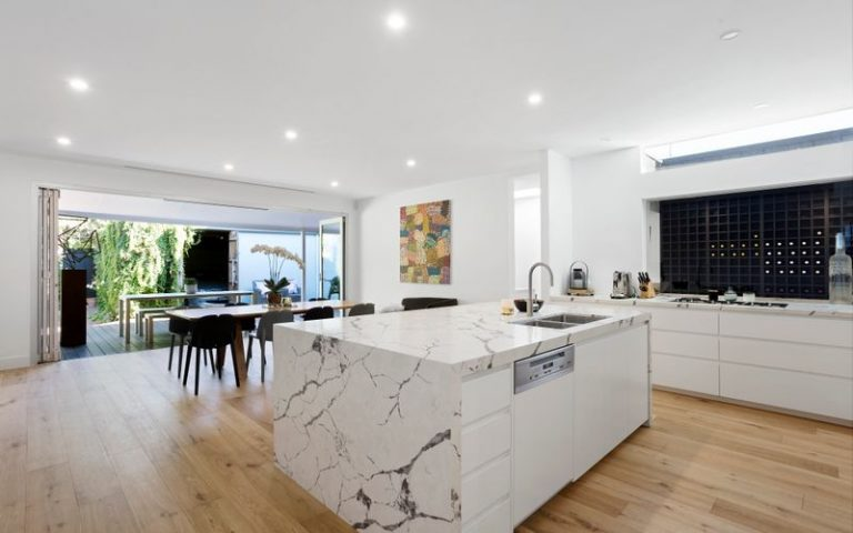 This Prahran kitchen has a statement bench top as its centrepiece. Picture: realestate.com.au