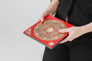 Chinese compass Lopan for Feng Shui technique in female hands is