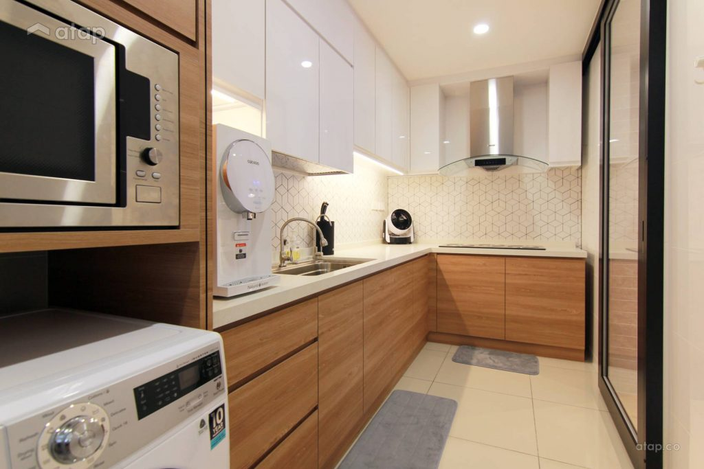 Modern kitchen with white and wooden theme, complete with microwave and washing machine