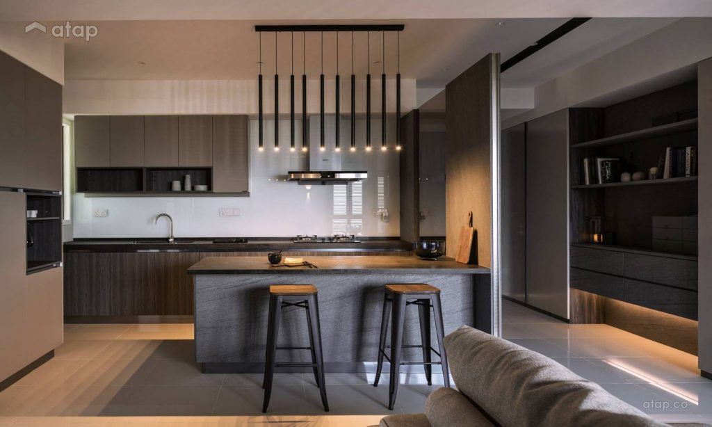 Black and bold kitchen design with hanging pendant lights