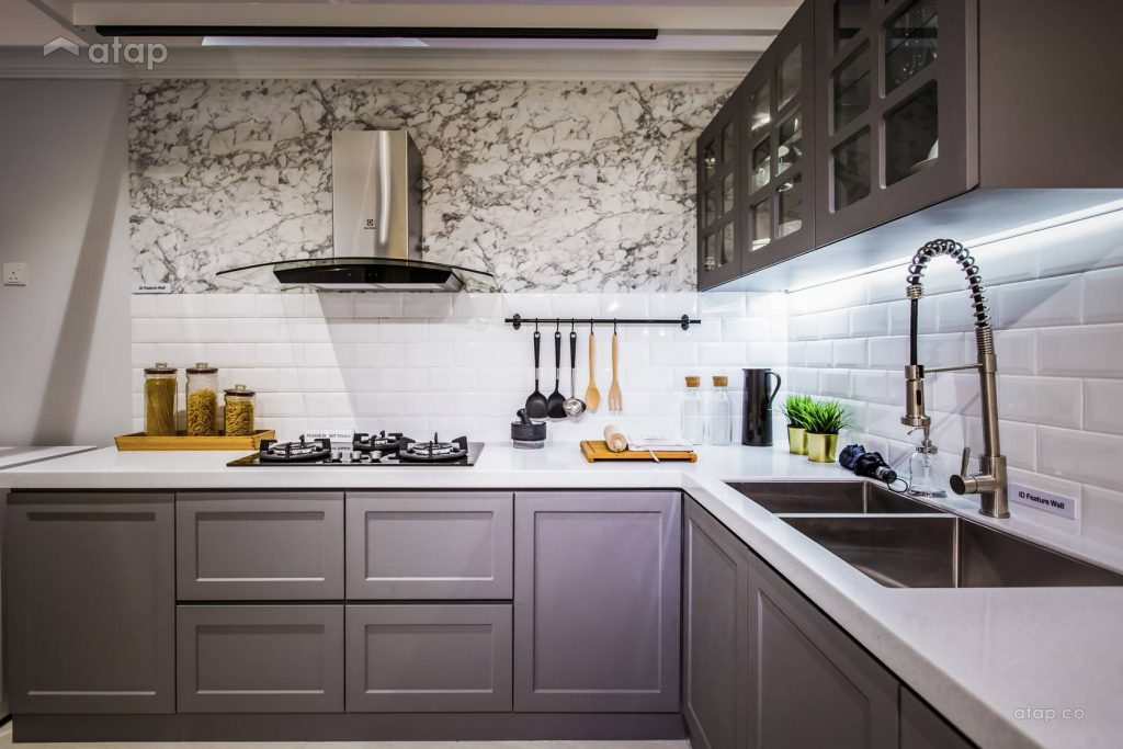 Small kitchen with subway tiles and gray cabinetry