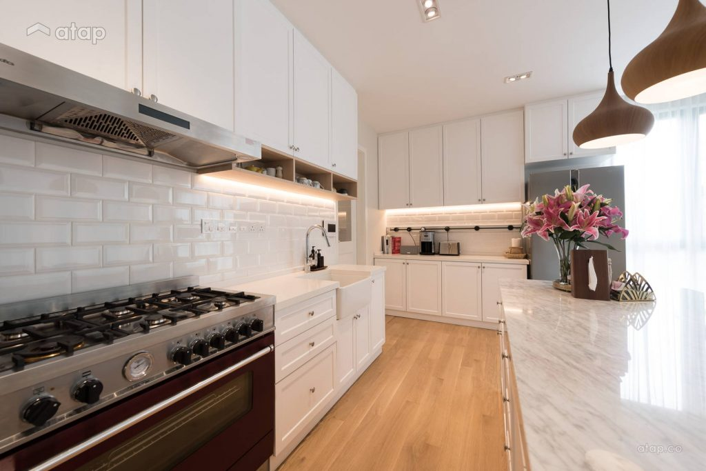 Kitchen with open plan design and a marble countertop
