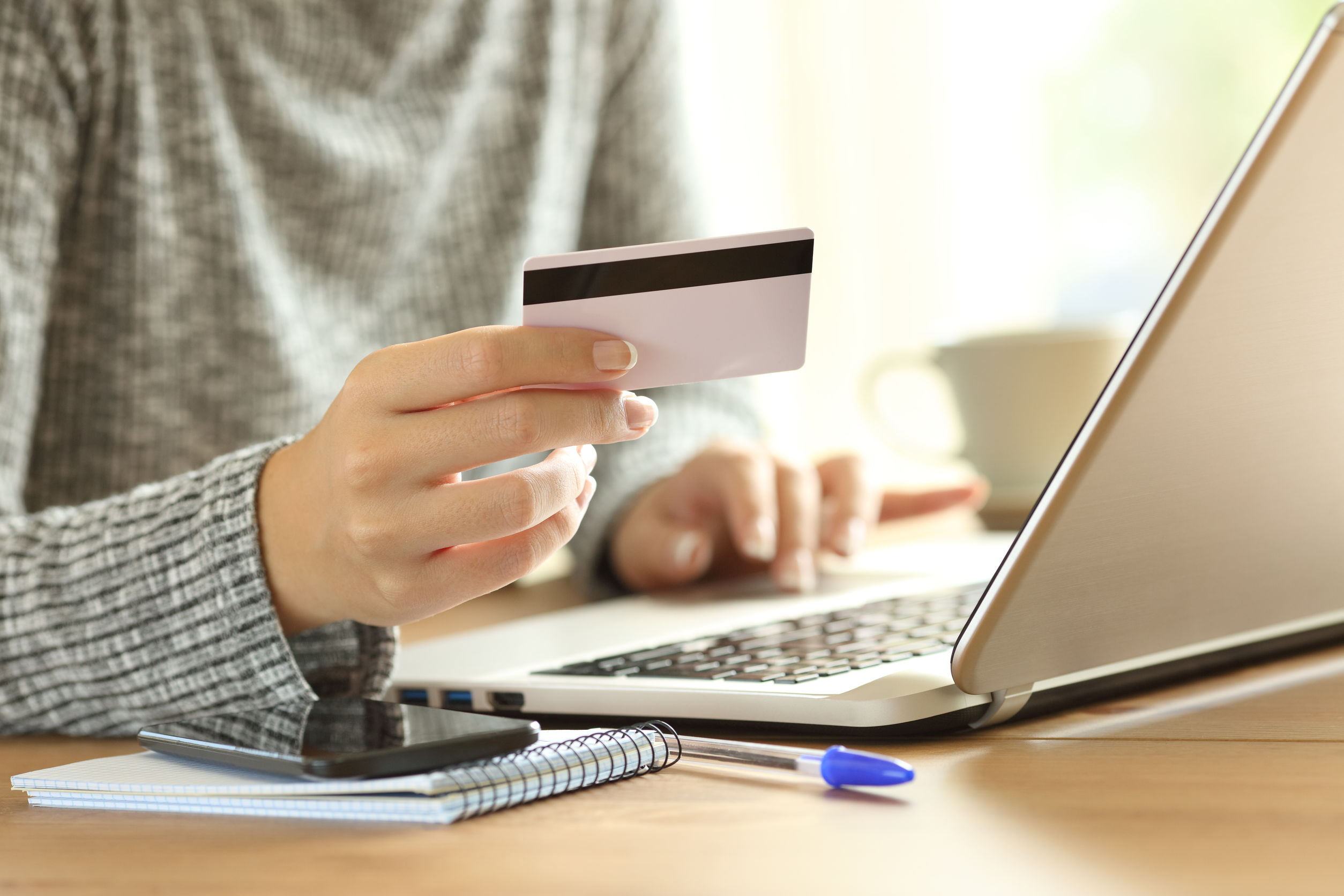 Woman hand paying on line with credit card