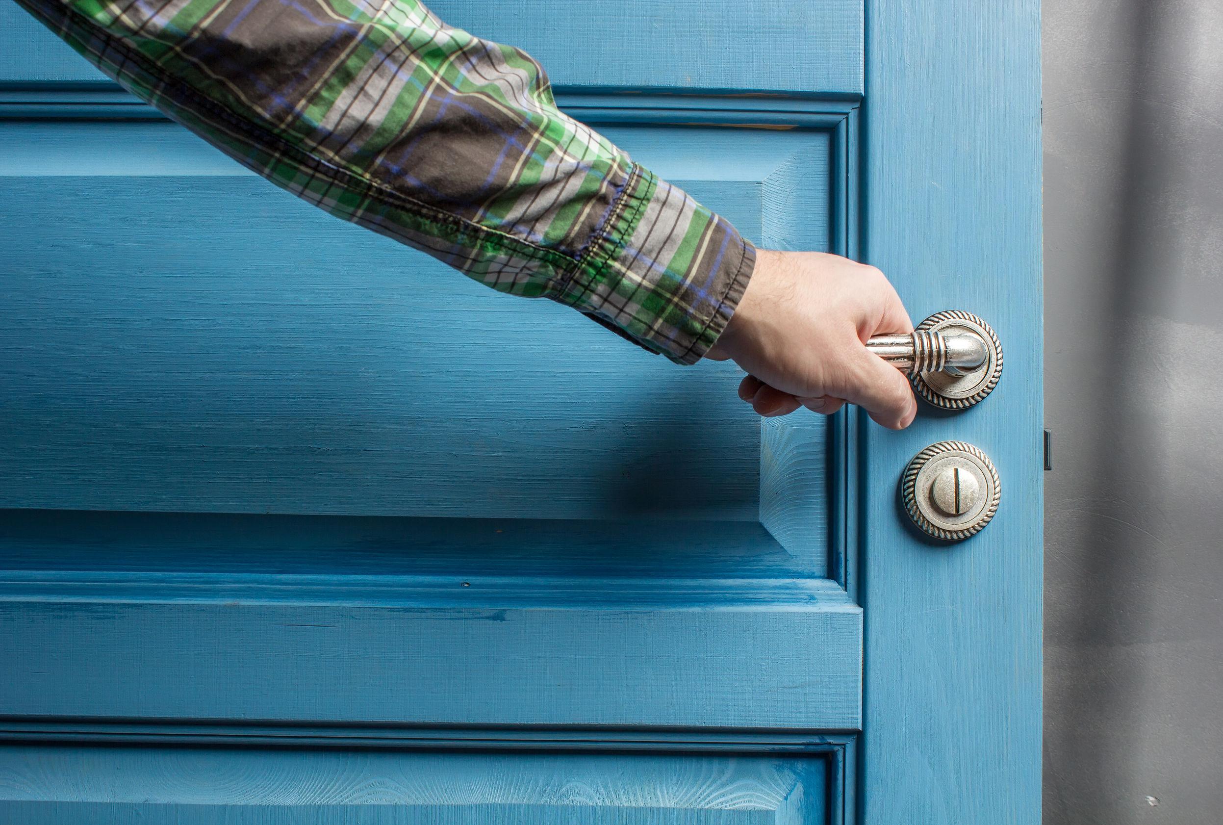 man opens the door knob