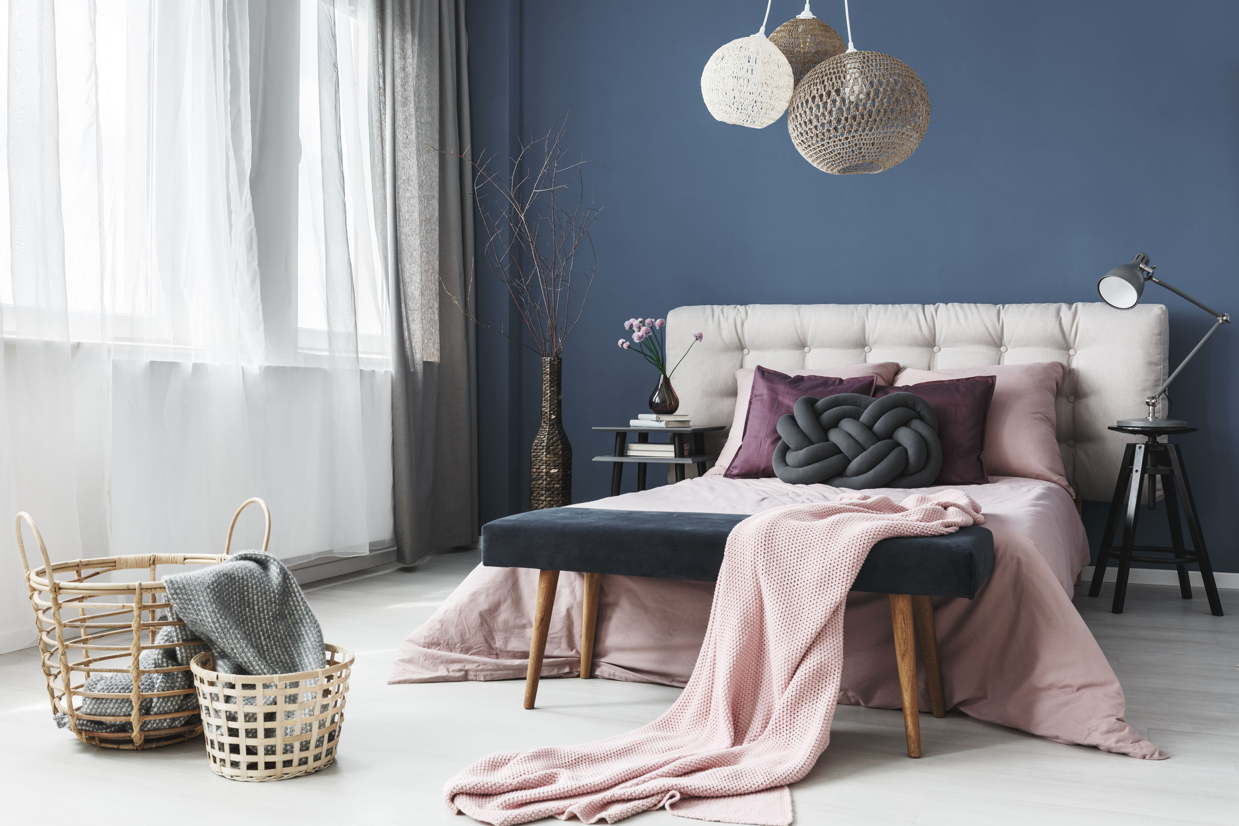pastel colour room with king-sized bed and a pendant lamp