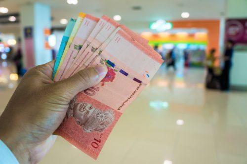 Malaysia money ringgit bill in hand