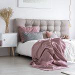 Bedroom with gray tufted headboard