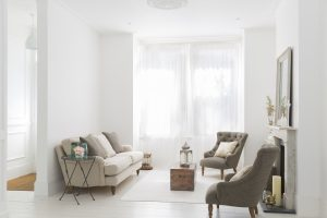 neutral-tone-living-room-with-two-sitter-sofas-coffee-table-and-armchairs