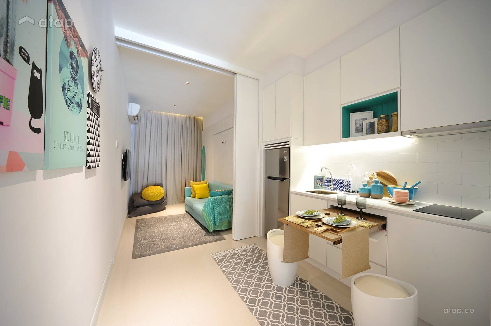 small-kitchen-with-pull-out-dining-table-in-a-studio-apartment