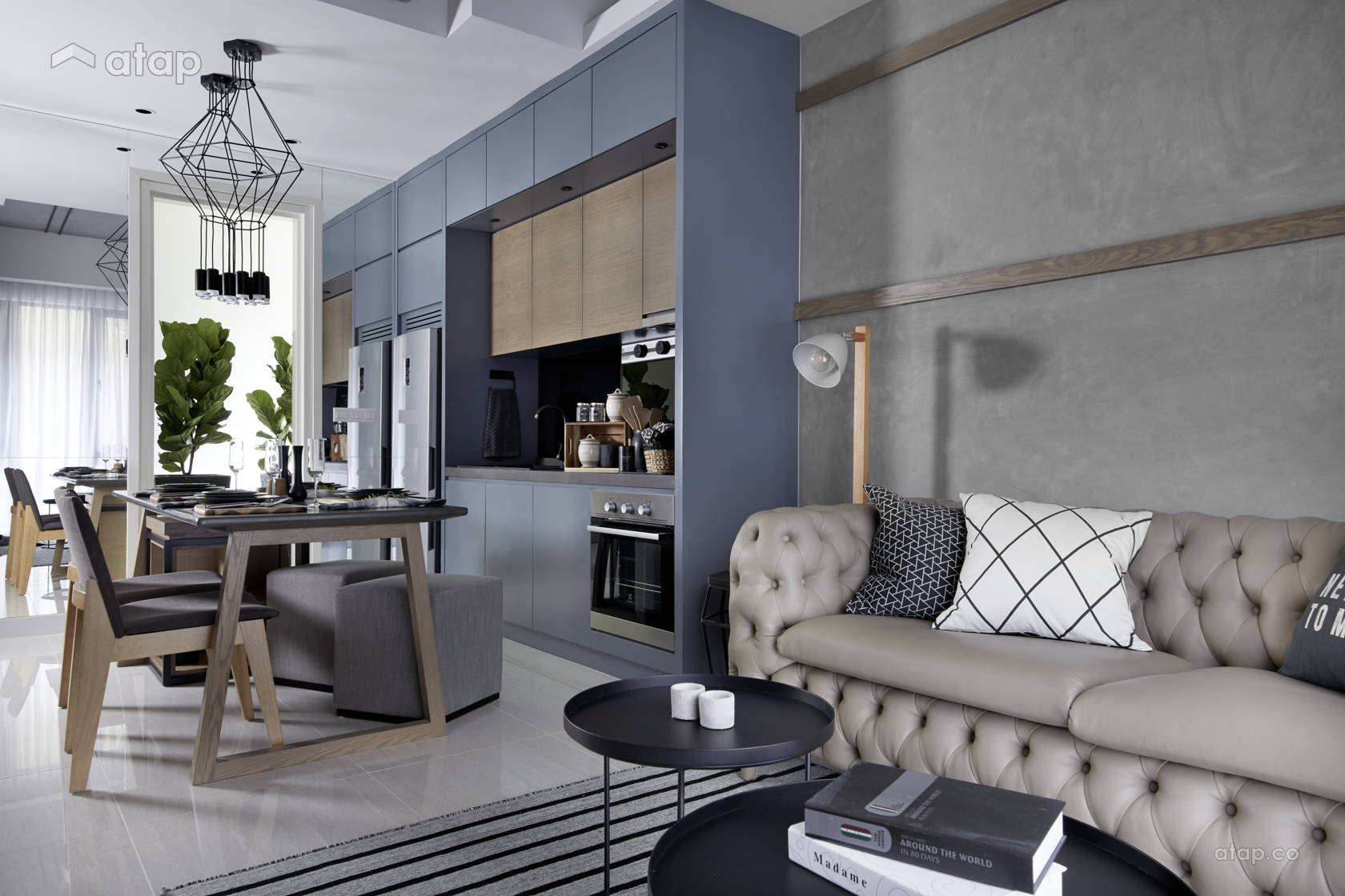apartment-with-blue-kitchen-wall-and-dining-table