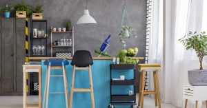 home-interior-dining-room-with-grey-wall-and-blue-kitchen-island