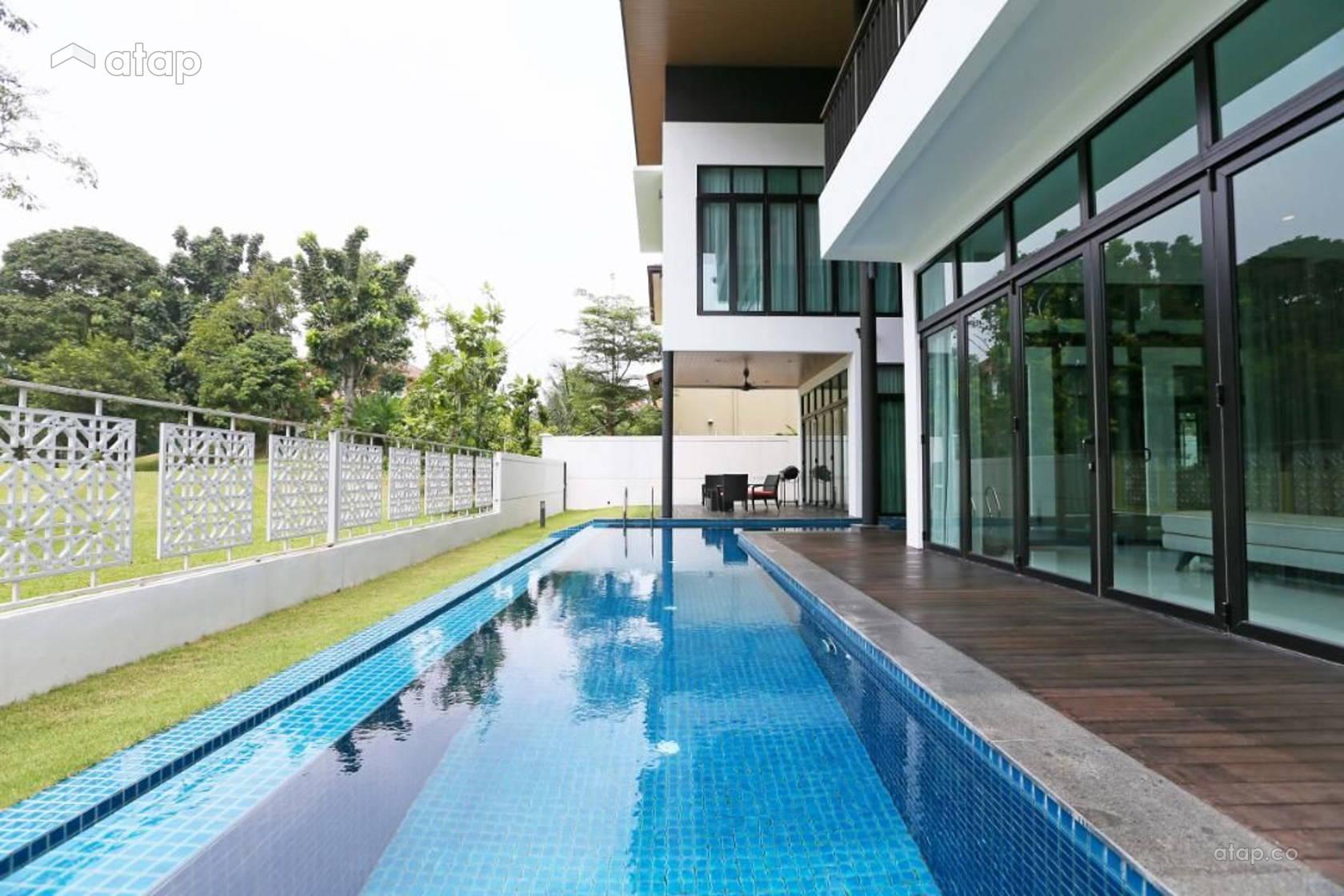 Inground swimming pool that curves around the house for maximum aesthetic pleasure at Haus Saujana Impian.