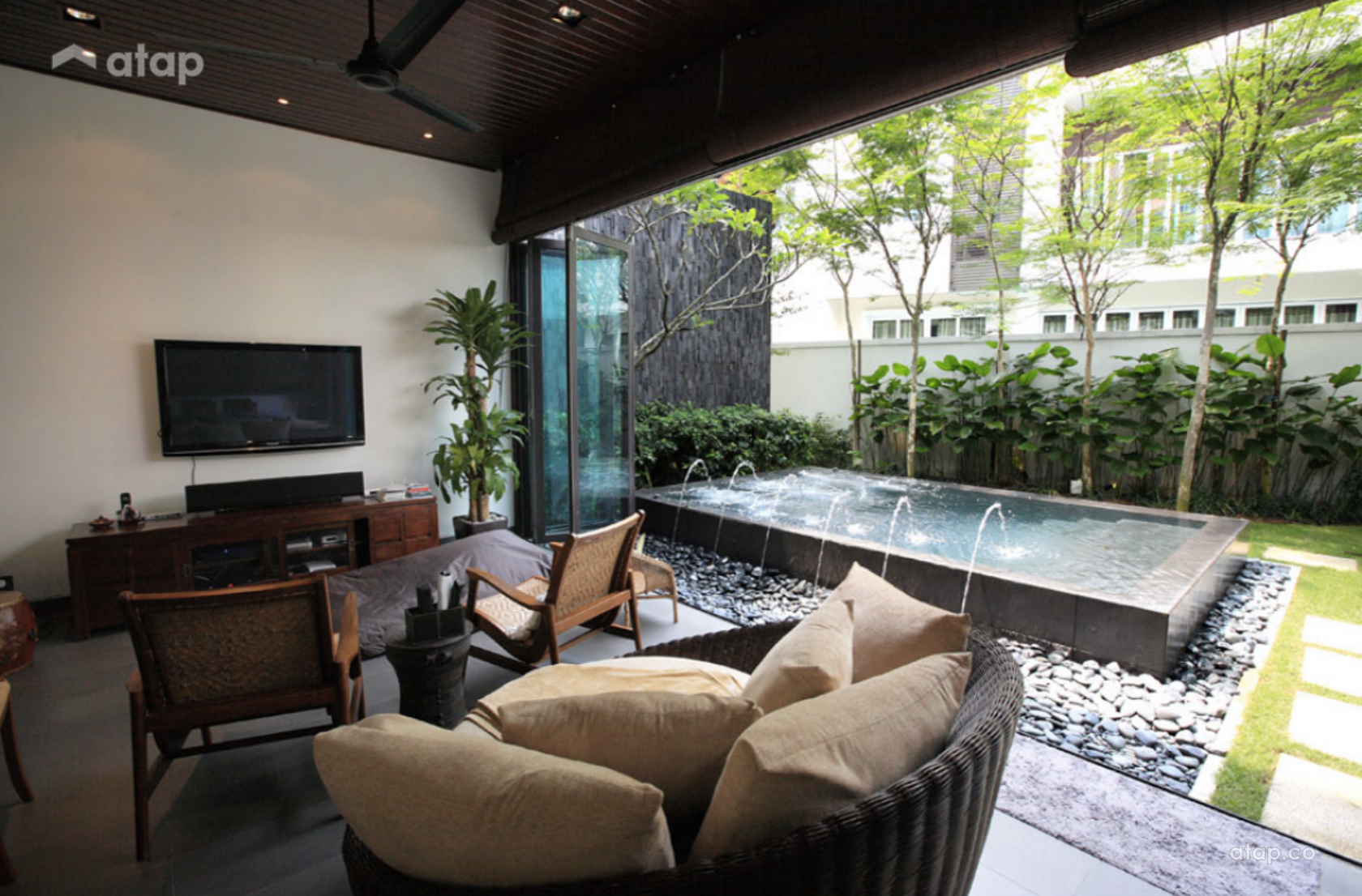 Small dipping pool with water features at a bungalow in Mutiara Damansara.