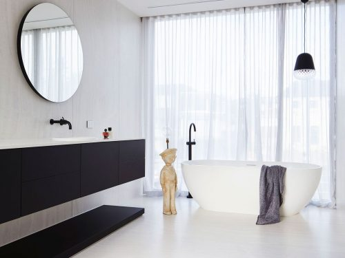 monochrome-black-and-white-bathroom-interior-with mirror-sink-bathtub-and-floor-to-ceiling-window