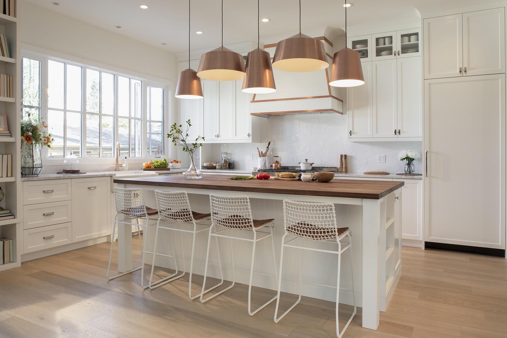 White-home-showcase-interior-kitchen-with-copper-pendant-lights