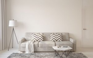 living room interior in scandinavian style with grey sofa, rug, monochrome pillows, coffee table and standing lamp