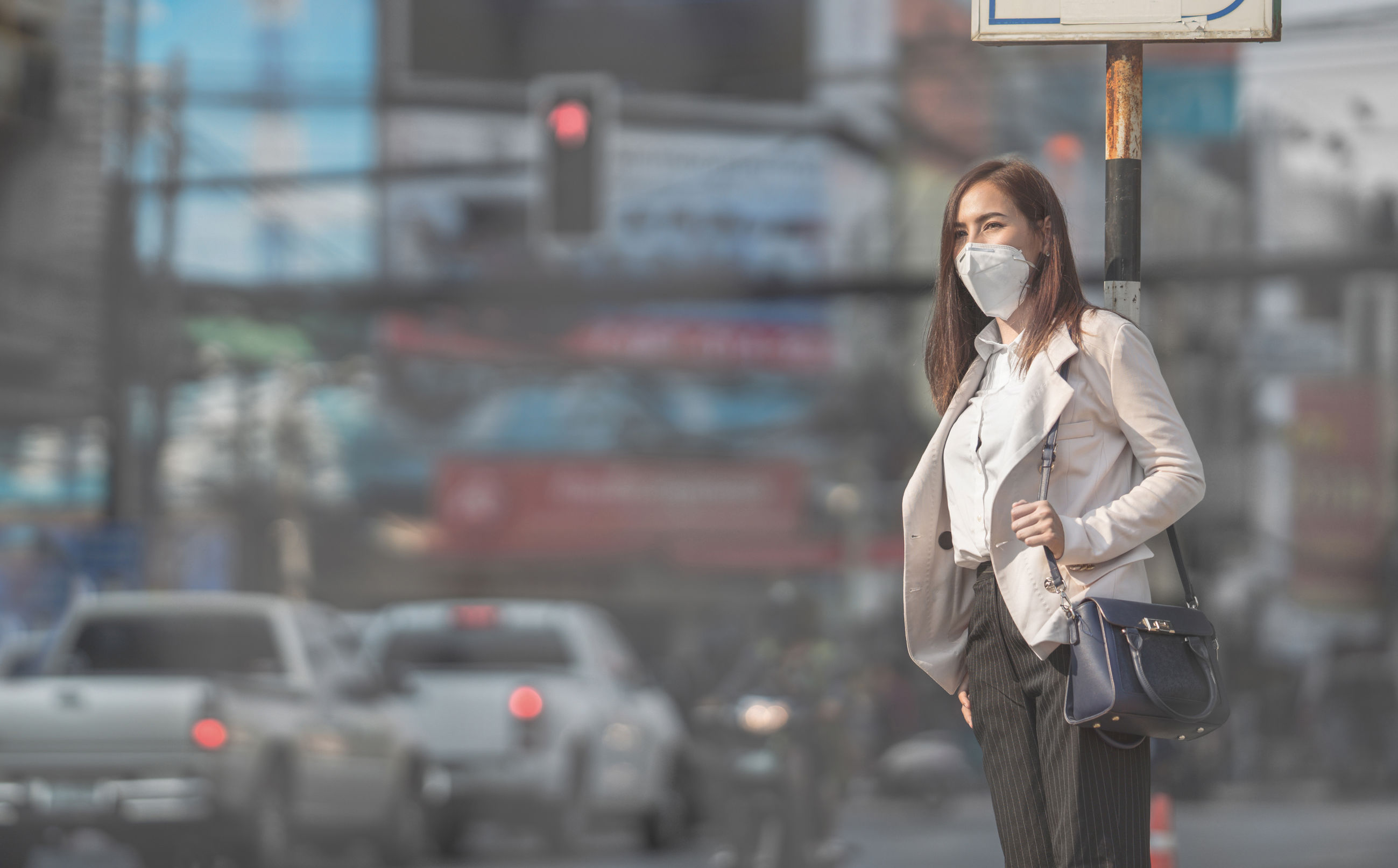 Asian woman are going to work.she wears N95 mask.Prevent PM2.5 d