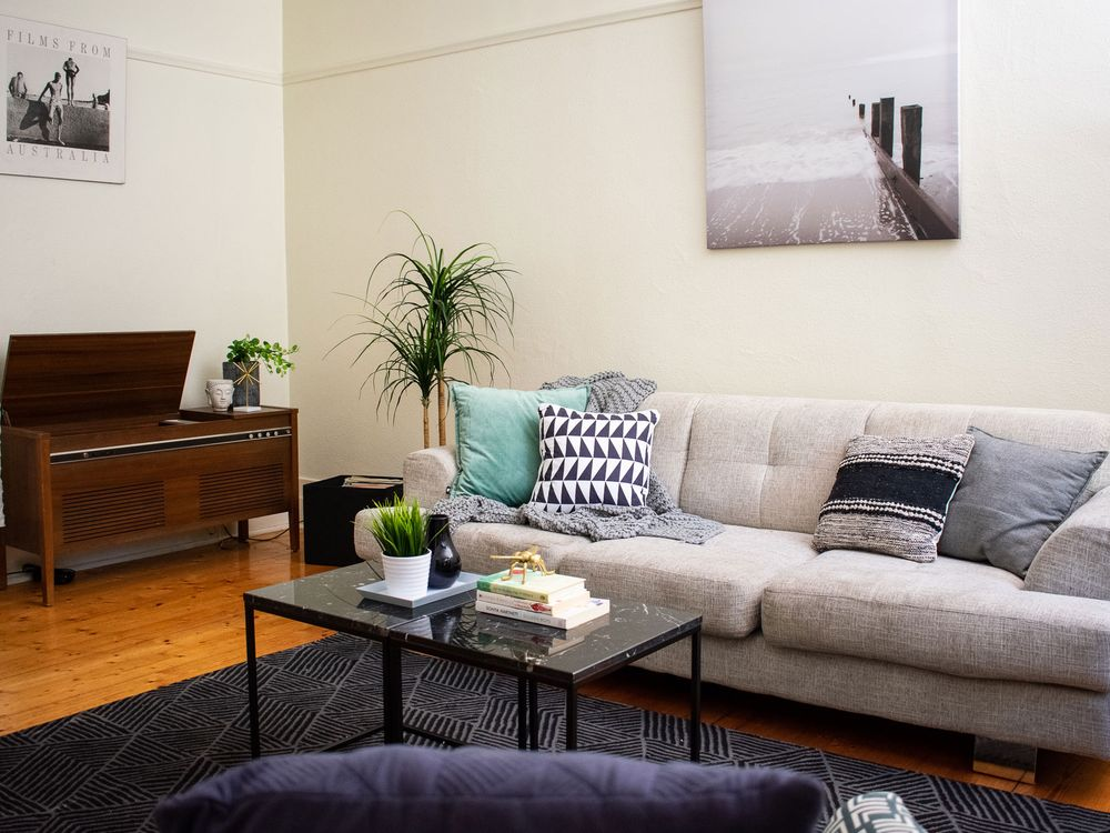 living-room-with-grey-sofa-table-coffee-table-and-wall-art