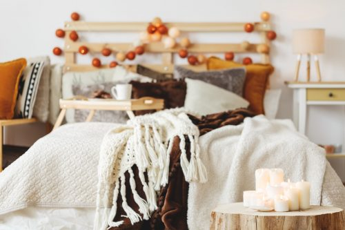 White candles on wooden trunk