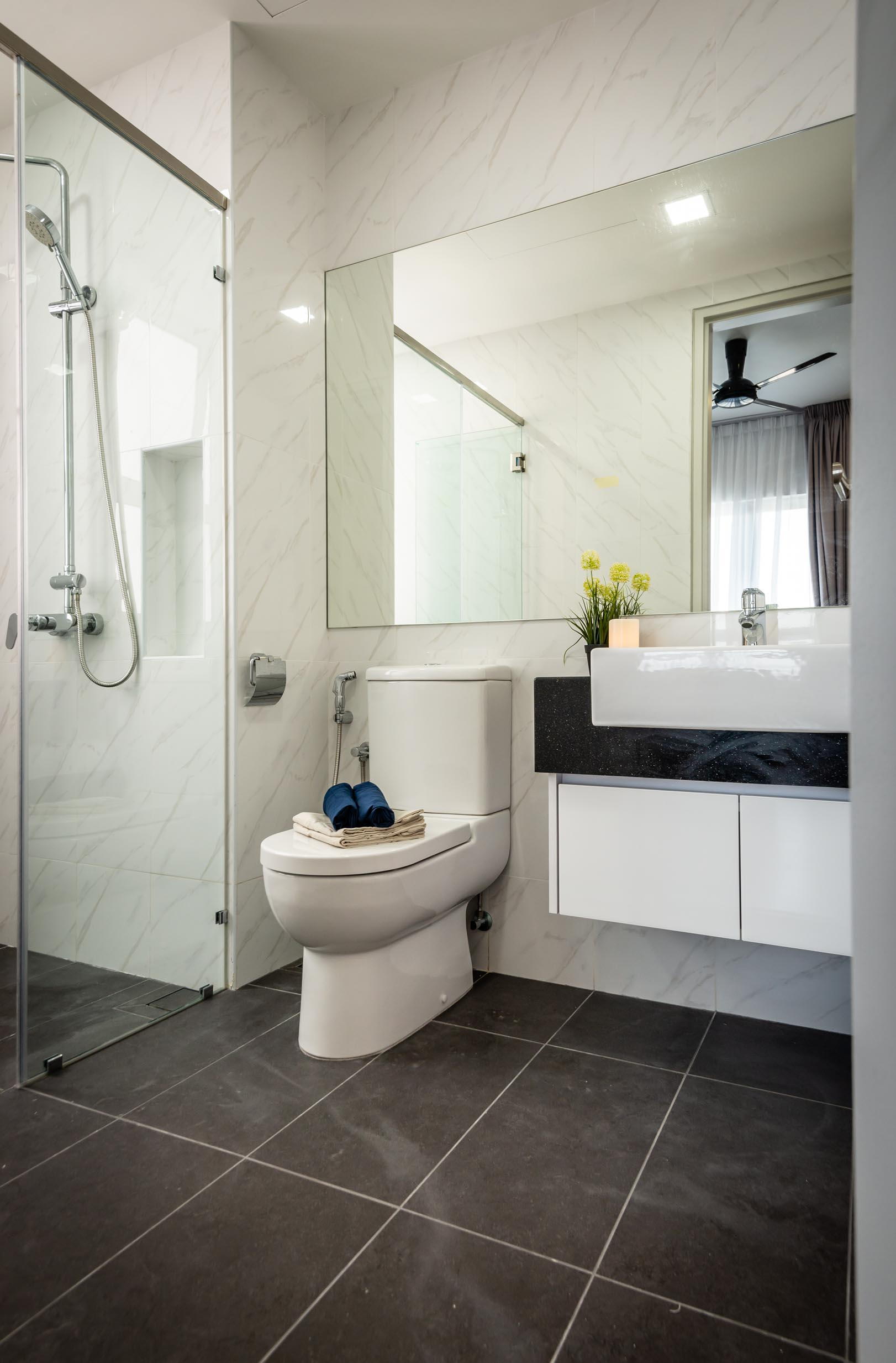 white coloured bathroom with shower door and floating vanity