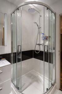 A modern quadrant shower enclosure with sliding doors
