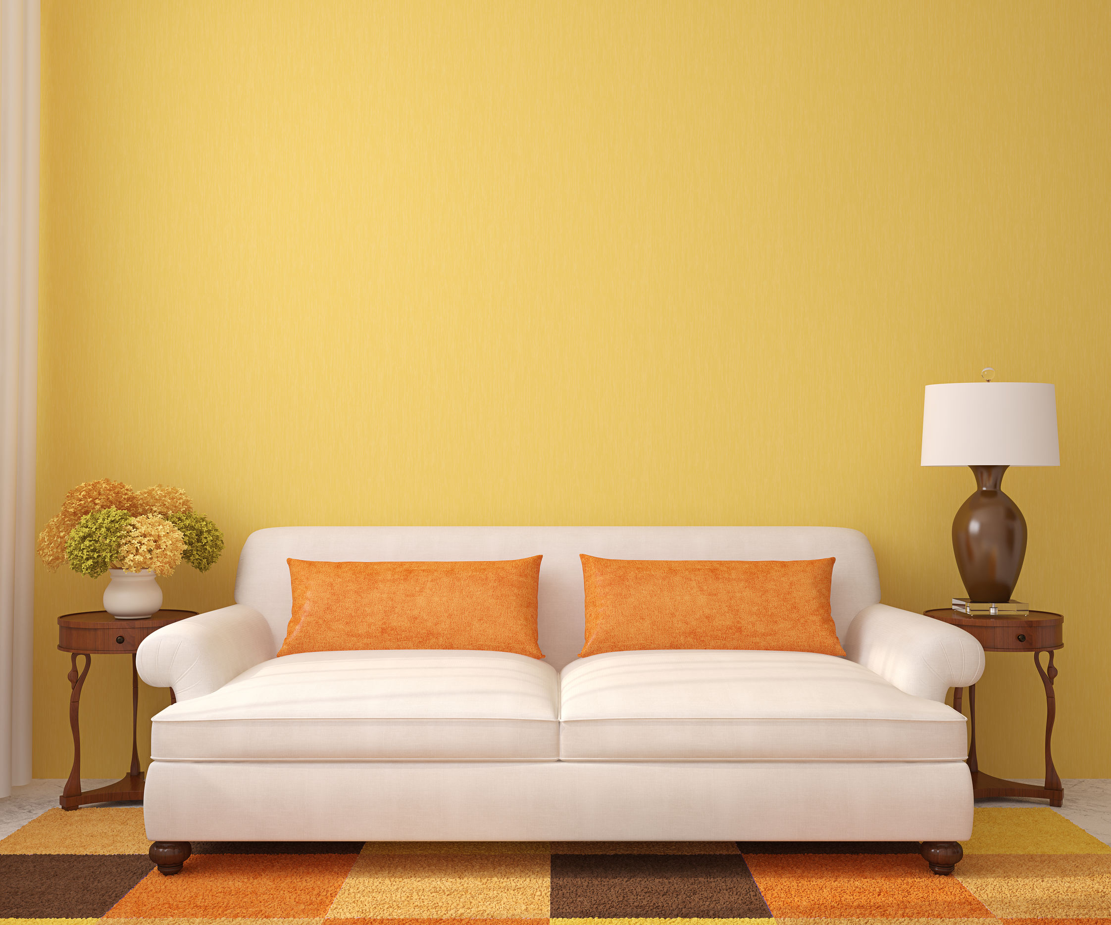Beautiful living-room with white couch near empty yellow wall