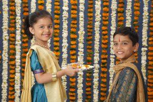 Sister holding aarti thali in front of brother on Rakshabandhan festival