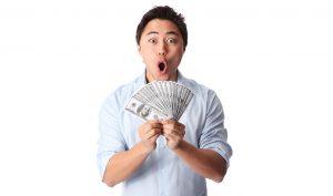 Man holding cash prize
