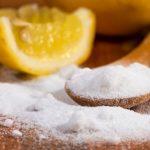 baking soda in a wooden spoon and lemon