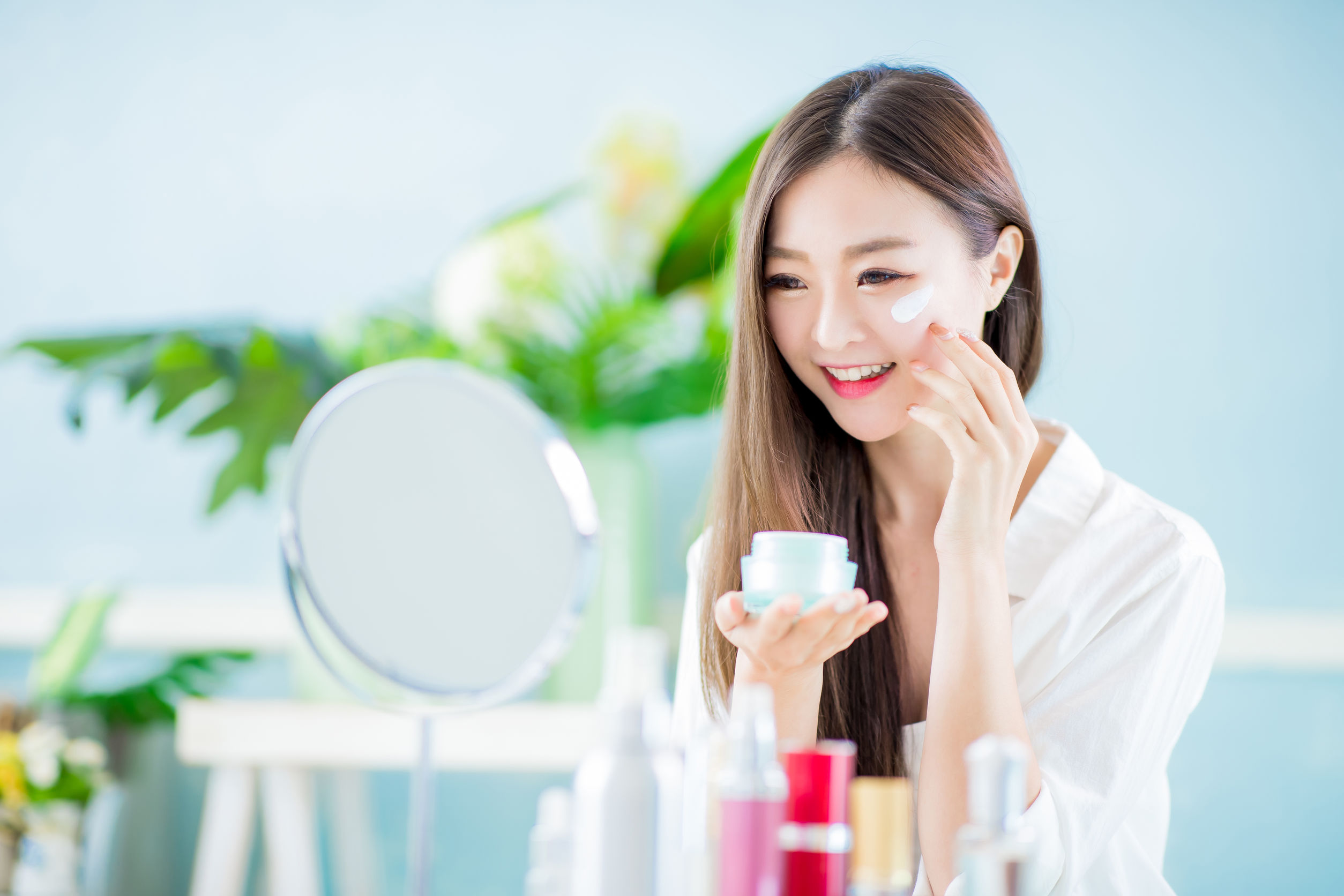woman apply skin care at home