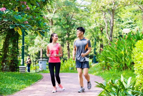 asian-chinese-man-and-woman-jogging-in-city-park-small