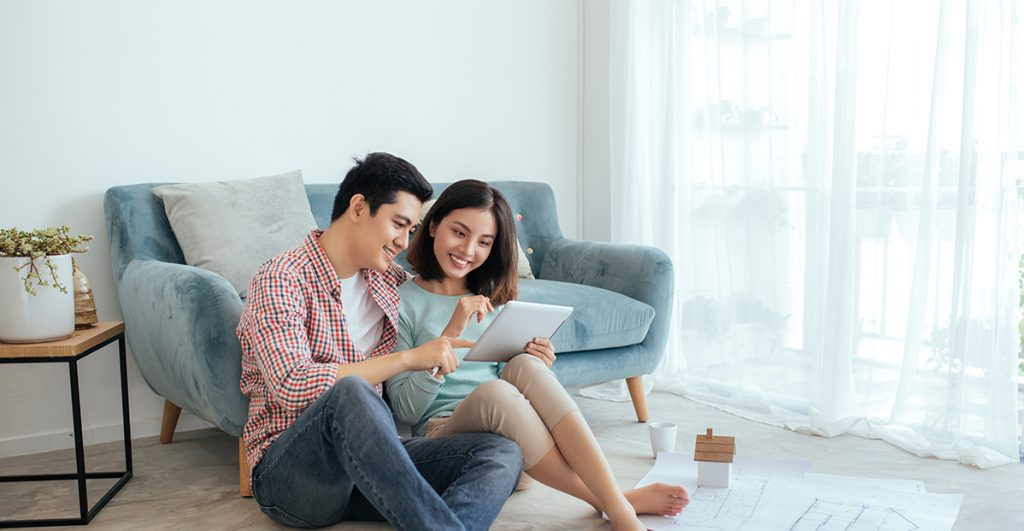 Couple-looking-at-their-home-main