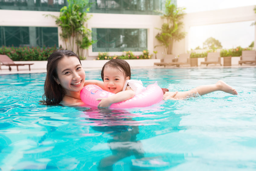 mother and baby swimming in a pool