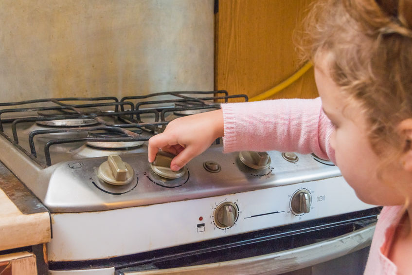 children playing with gas stove