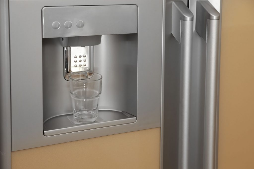 Refrigerator with ice and water dispenser