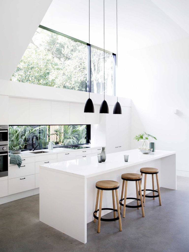 Black pendant lights in the kitchen to create a pop of colour.