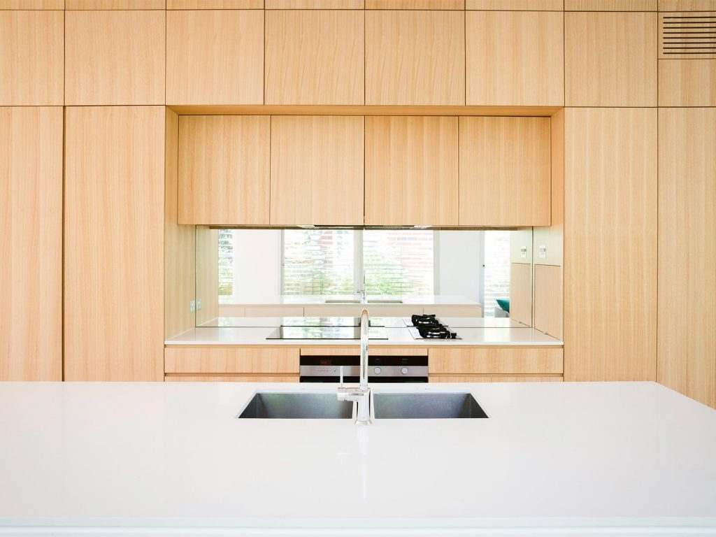 Double sinks on a kitchen island for convenience.