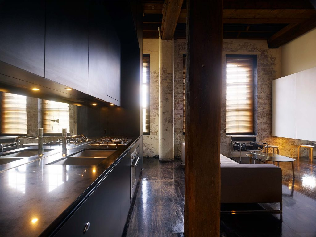 Industrial kitchen design in a warehouse apartment inspired home.