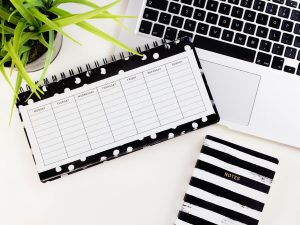 Desk-with-organiser-loptop-and-schedule