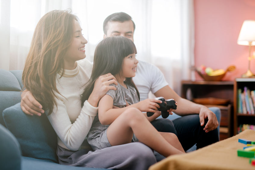 asian-family-playing-video-game-console
