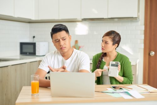 young couple worried about financial bills