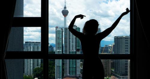 woman-overlooking-kl-tower