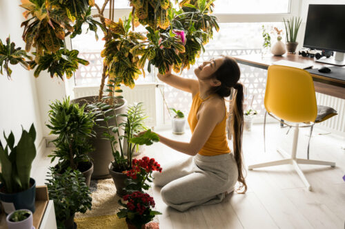 woman-taking-care-of-plants-happily